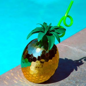 Shiny golden pineapple disco ball-shaped sippy cup with a locking lid and straw for portable relaxation. In an insulated design for keeping drinks extra chilled, whether you're on vacation or just pretending to be.
